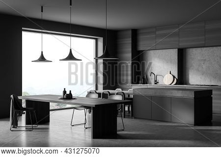 Corner View On Dark Kitchen Room Interior With Dining Table, Twelve Chairs, Concrete Floor, Electric