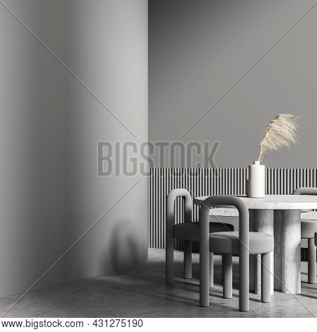 Grey Living Room Interior With The Round Table Near A Ledge Basement, A Passage, An Empty Wall Parti