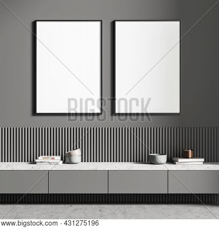 Two Empty Framed White Canvas In The Grey Living Room Interior With A Basement Ledge, Having The Wal