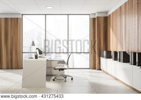 Side View On Office Interior With Panoramic Window With City Skyscraper, Laptop, Armchair, Wooden Wa