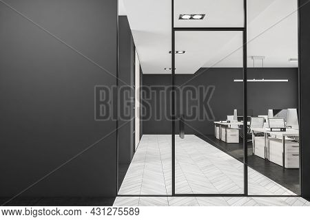 Dark Office Room Interior With Four Computers, Armchairs, Black Empty Wall, Glass Door And Partition