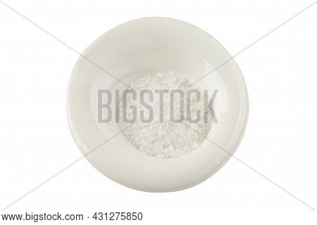 Crystals Of Coarse Sea Salt In A White Plate. Healthy Foods From Nature. Isolated On White Backgroun