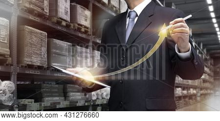 Businessman Use Tablet Plan, Check Of Logistics Transportation In Warehouse. Business Man Manage Sma