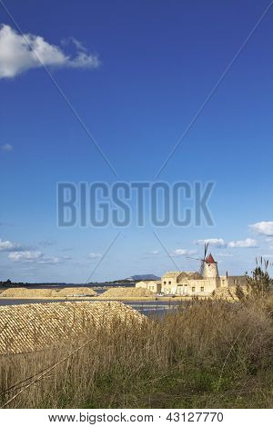 Saltern landscape with windmill near Marsala, Sicily