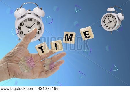 A Hand Reaching Out To Catch Falling Wooden Cubes Labelling With A Text 'time' With Moving Away Whit