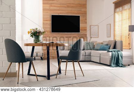 Modern Wide Screen Tv On Wall In Room With Stylish Furniture