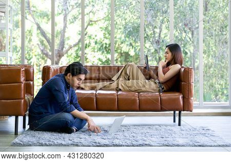 Young Lovers Spend Time Together On Holidays In The Living Room. The Man Wore Comfortable Clothes Us