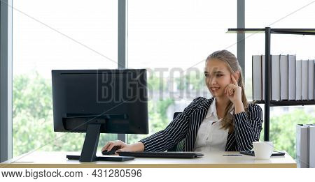 Caucasian Apprentice In Suit Smiling Happily As She Embarks On A Modern Office Trial.