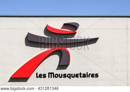 Saint-trivier, France - August 10, 2019: Les Mousquetaires Logo On A Wall. Les Mousquetaires Is A Pr