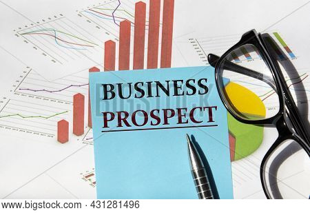Business Prospect - A Word On A Piece Of Paper For Notes On The Background Of A Graph And Glasses. B