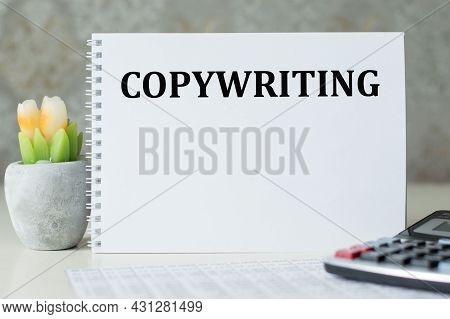 Copywriting Text On A Notebook That Stands On The Table Next To The Calculator, Financial Statements