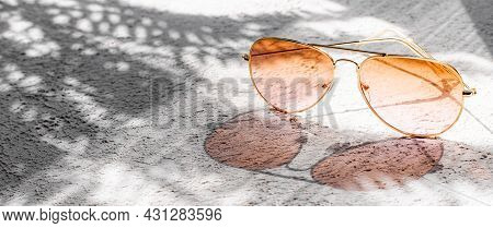 Sunglasses With Sun Shadows . Summer Layout. Women's Sunglasses. Sun Protection. Copy Space