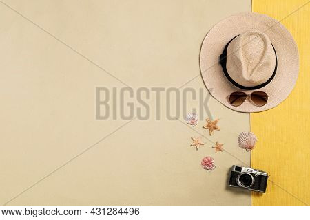 Beach Towel, Hat, Sunglasses, Camera, Starfishes And Sea Shells On Sand, Flat Lay. Space For Text