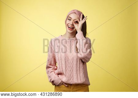 Cheerful Girl Saying Ok. Attractive Stylish Shoolgirl In Knitted Sweater Relaxed Feeling Upbeat, Sha