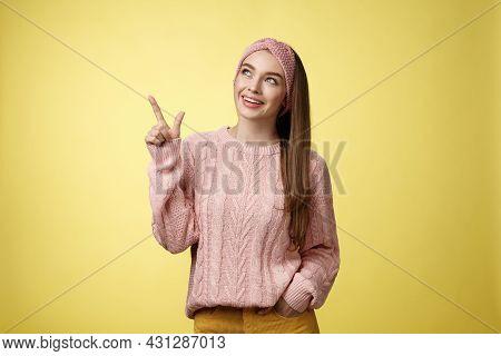 Portrait Of Amused Interested Cute 20s European Girl Wearing Sweater, Headband Looking Upper Left Co
