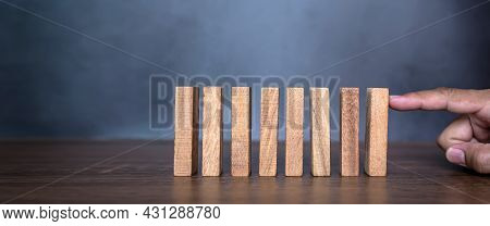 Close-up Fingers Prevent The Wooden Block From Falling Domino Concepts Of Financial Risk Management
