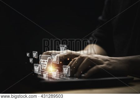 Businessman Using Computer Laptop With Shopping Trolley Cart Icon For Input Order For Online Shoppin