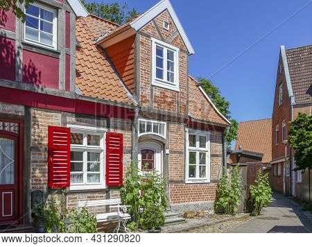 Sunny Scenery With Historic Houses At Travemuende In Germany