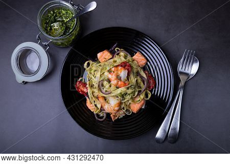 Noodles With Seafood, Sun-dried Tomatoes, Capers And Red Onions. Homemade Pasta With Shrimp, Salmon