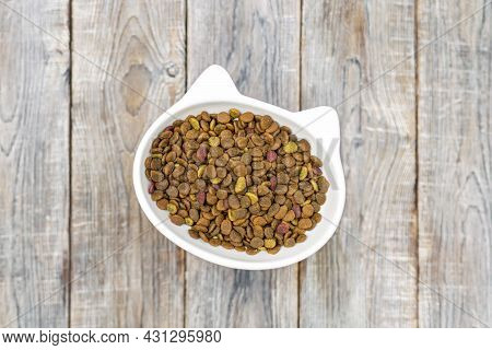 Cat Head Bowl With Dry Food On Wooden Background With Copyspace. Healthy Pet Diet Nutrition, Feline
