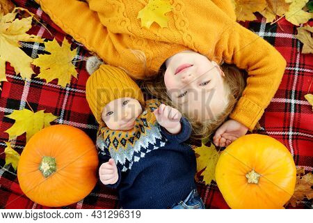 Cute Big Sister Cuddling With Her Baby Brother. Adorable Girl Holding Her Baby Boy Brother. Having F