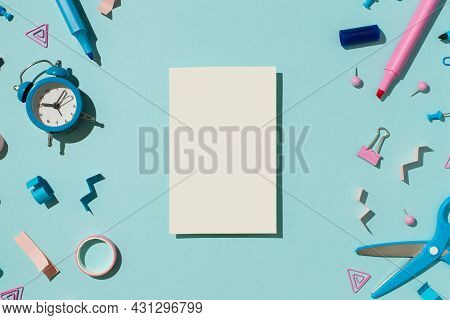 Top View Photo Of Vertical White Sheet Of Paper Bicolor Blue And Pink Stationery Pens Binder Clip Pu