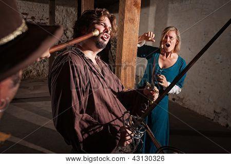 Swordsman Hit With A Mace