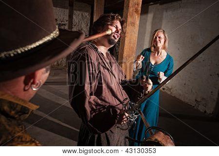 Woman Watches Swordsman Get Hit