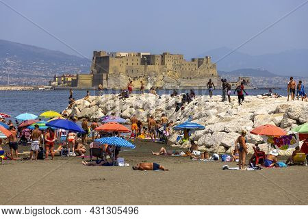 Naples, Gulf Of Naples, Italy - June 27, 2021: People Relaxing On The Mappatella Beach By The Tyrrhe