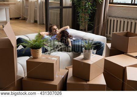 Joyful Millennial Spouses Enjoying Carefree Time In Own Dwelling.