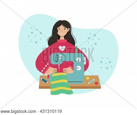 The Girl Sews On A Sewing Machine. Creative Profession.