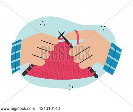 Knitting Clothes On Knitting Needles. Creative Activity.