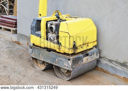 Manual Compact Asphalt Roller For Tamping Soil At A Construction Site