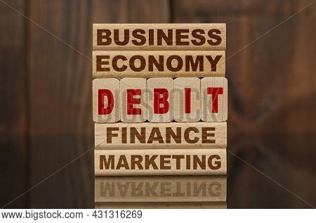 Finance And Economics Concept. Wooden Blocks With The Text - Business, Economy, Finance, Marketing A