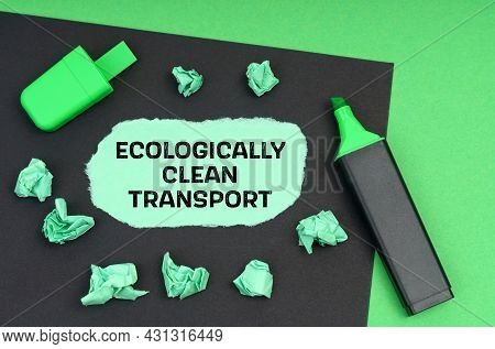 Ecology Concept. On A Green Background, A Marker, A Black Sheet And Torn Paper With The Inscription