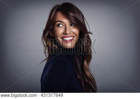 Beautiful Smiling Woman With White Teeth Standing At Isolated Grey Background. Happy Woman Wearing T