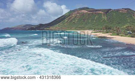 Flight Over Rocky Coast Of Tropical Island Of Oahu Hawaii. View Of Sandy Beach. Pacific Ocean Coastl
