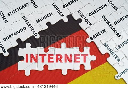 National Concept. On The Flag Of Germany There Are Puzzles With The Names Of Cities And Puzzles With