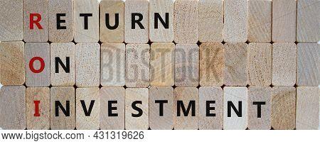 Roi, Return On Investment Symbol. Wooden Blocks With Words 'roi, Return On Investment'. Beautiful Wo
