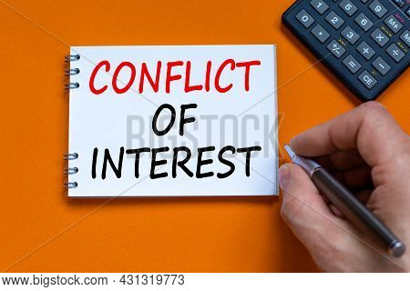 Conflict Of Interest Symbol. Businessman Writing Words 'conflict Of Interest' On White Note. Black C