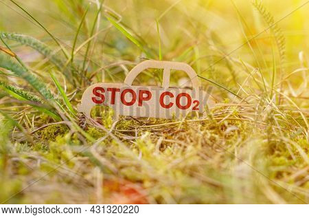 Ecology And Transportation Concept. There Is A Wooden Car In The Grass That Says - Stop Co2