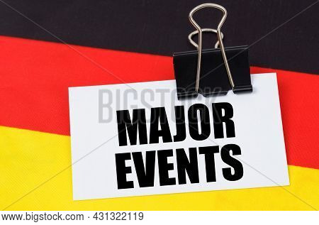 Politics And People Concept. On The Flag Of Germany Lies A Notebook With The Inscription - Major Eve