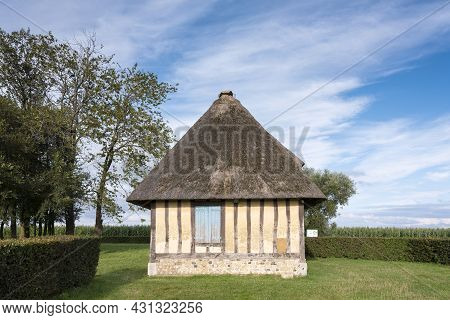 Beautiful Half Timbered Old Farm In French Normandy Under Blue Summer Sky