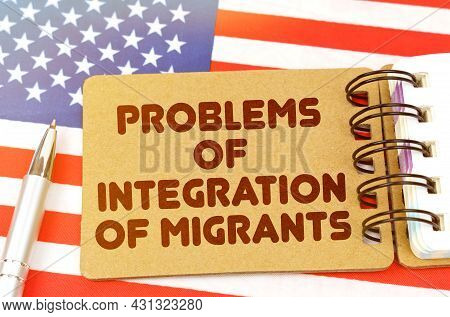 Politics And People Concept. On The Us Flag Lies A Notebook With The Inscription - Problems Of Integ