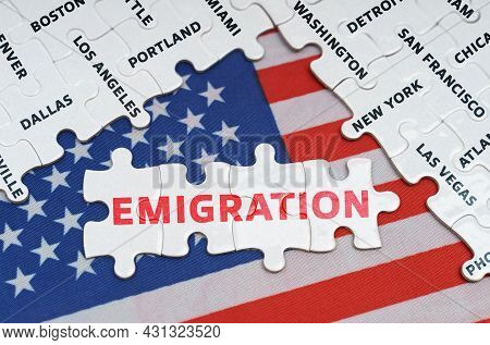 National Concept. The Usa Flag Has City Name Puzzles And Puzzles With The Inscription - Emigration