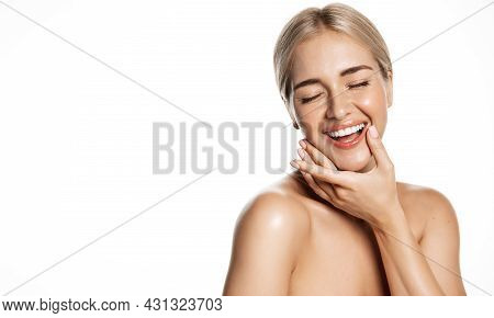 Beauty And Spa. Healthy Happy Woman With Glowing, Hydrated Skin, Perfect White Smile, Holding Hand N