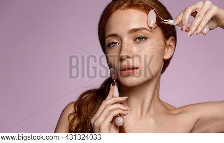 Gua-sha Facial. Young Redhead Woman Using Jade Stone Rollers On Face, Doing Skin Massage, Face Lift