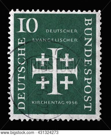 ZAGREB, CROATIA - JUNE 25, 2014: Stamp printed in Germany, shows Five crosses, German Evangelical Church Assembly, circa 1956
