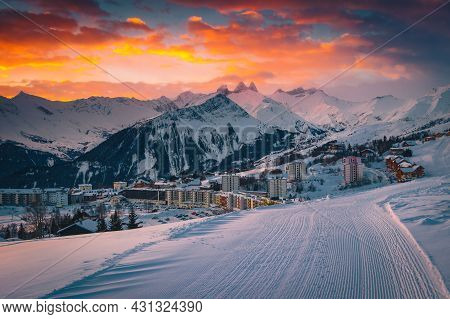 Fantastic Alpine Winter Ski Resort With Buildings And Beautiful Mountains At Dawn. Famous Resort And