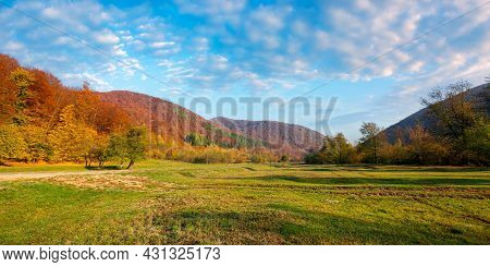 Countryside Valley On Autumn Morning. Panoramic Scenery Of Carpathian Mountains With Forest In Color